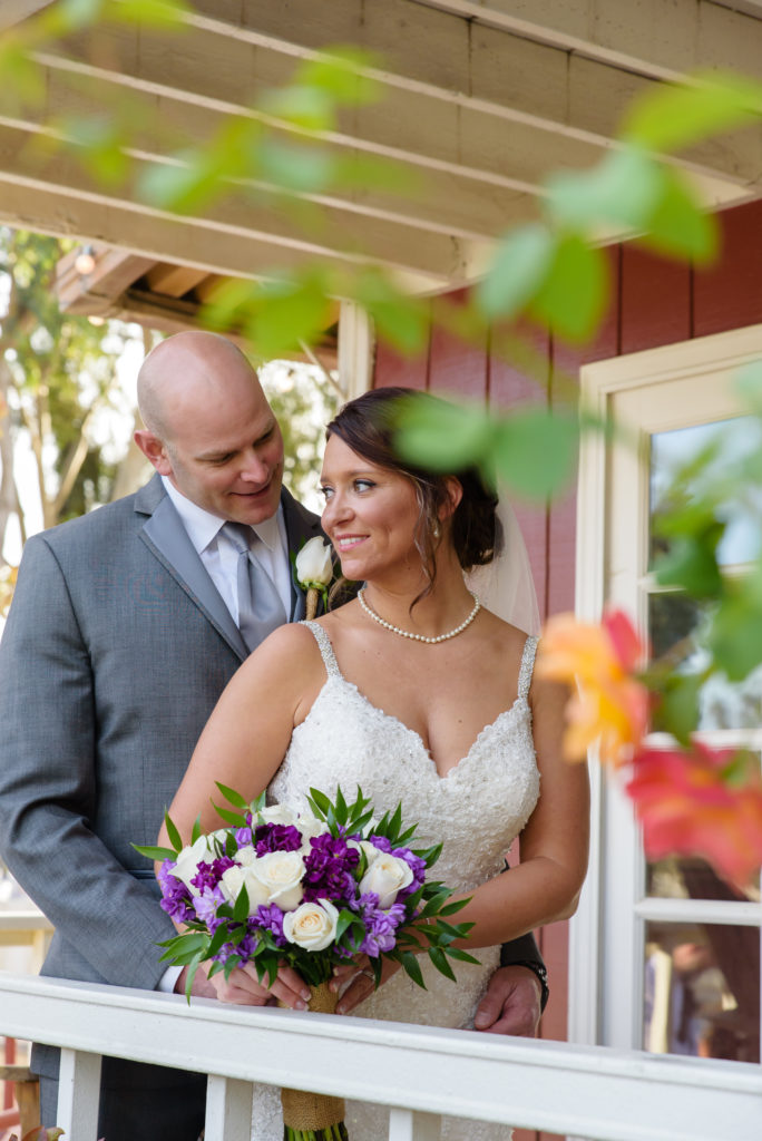 Romantic Couple shot on the porch at The Red Horse Barn Wedding Venue