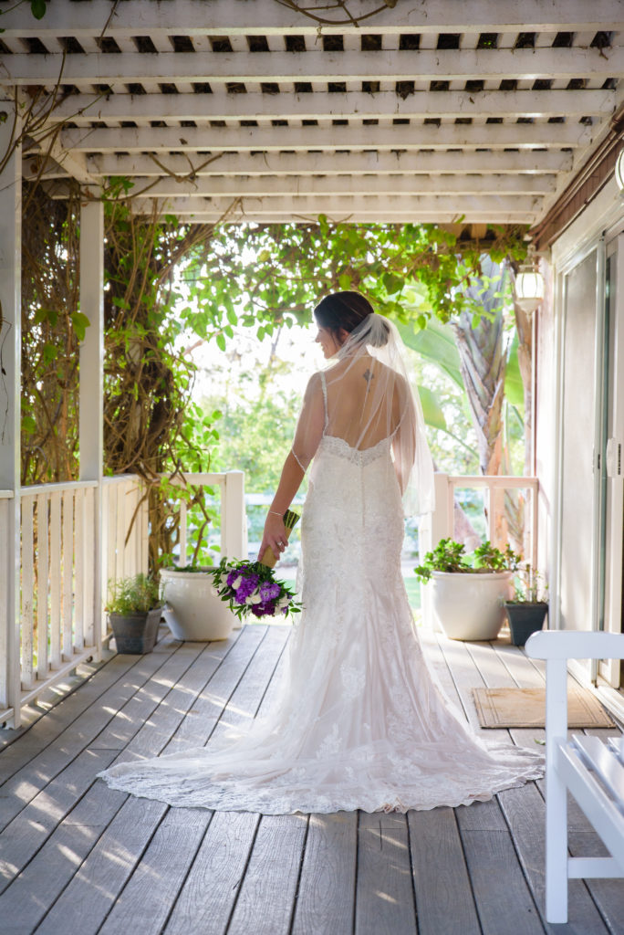 Bridal Portrait on the Porch before her wedding ceremony at The Red Horse Barn in Orange County