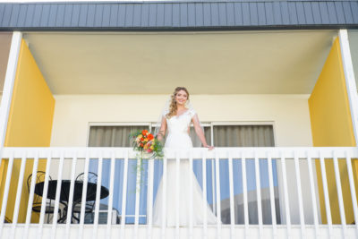 Bride on the Balcony at The Anaheim Hotel across the street from Disneyland. Anaheim Wedding and Event Venue
